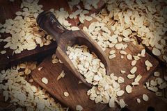 Rolled oats with a spoon. Close up on a wooden table royalty free stock photography