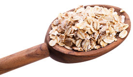 Rolled oats in the spoon. Royalty Free Stock Photo