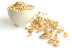 Rolled oats in a teacup Stock Image