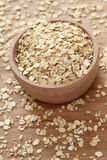 Rolled oats in a wooden bowl. Close-up Royalty Free Stock Photos