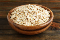 Rolled oats in a wooden bowl Stock Image