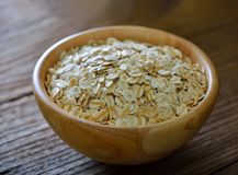 Rolled oats on a wooden Royalty Free Stock Image
