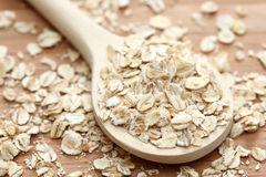 Rolled oats in the wooden spoon Stock Photo