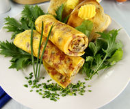 Rolled Omelette. Delicious rolled mushroom and bacon omelette freshly prepared and ready to serve Royalty Free Stock Image
