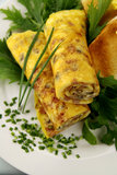 Rolled Omelette. Delicious rolled mushroom and bacon omelette freshly prepared and ready to serve Stock Photography