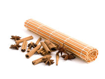 Rolled orange bamboo mat with aromatic spices Royalty Free Stock Photos