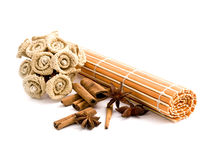 Rolled orange bamboo mat with aromatic spices Royalty Free Stock Photo