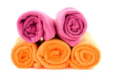 Rolled orange and pink towels Royalty Free Stock Images