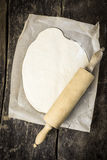 Rolled out dough for a pizza base Royalty Free Stock Image