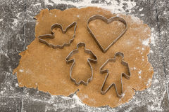 Rolled out gingerbread dough with cookie cutters. Rolled out gingerbread dough with typical christmas cookie cutters stock photo