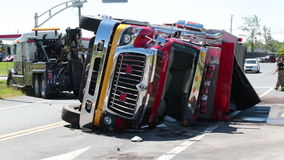 Rolled over firetruck. Heavy tow trucks try to bring back up. stock footage