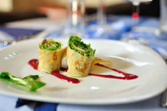 Rolled pancake appetizer on white a plate Stock Image