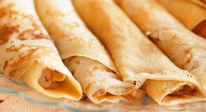 Rolled pancakes. Several appetizing rolled pancakes closeup on table Royalty Free Stock Photography
