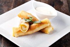Rolled pancakes stock photos
