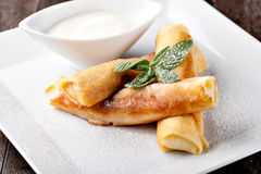 Rolled pancakes. With powdered sugar and mint Stock Photography