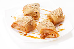 Rolled pancakes with caramel mousse Stock Photo