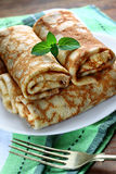 Rolled pancakes. With cottage cheese close up Royalty Free Stock Images