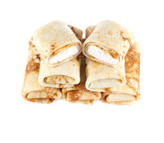 Rolled pancakes with cottage cheese. On a light background Royalty Free Stock Photo