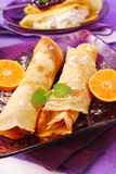 Rolled pancakes with orange Stock Image