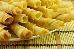 Rolled Pancakes Pile. On Bamboo Placemat, close-up Royalty Free Stock Images