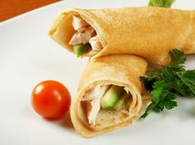 Rolled pancakes stuffed chicken Royalty Free Stock Photo