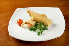 Rolled pancakes stuffed chicken Royalty Free Stock Image