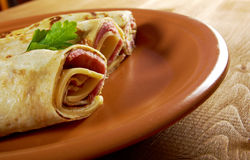 Rolled pancakes stuffed ham and cheese. Royalty Free Stock Photos