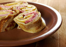 Rolled pancakes stuffed ham and cheese. Stock Photo