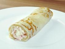 Rolled pancakes stuffed ham Royalty Free Stock Images