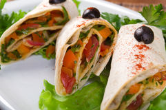 Rolled pancakes stuffed with vegetables Royalty Free Stock Photos