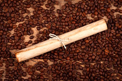 Rolled paper with coffee beans Stock Photos