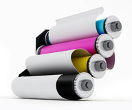 Rolled paper inside CMYK printing cylinders Royalty Free Stock Images