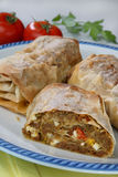 Rolled pastry with meat Stock Image