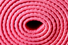 Rolled pink mat Royalty Free Stock Photo