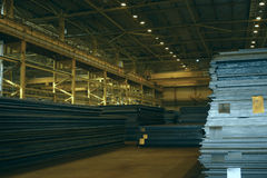 Rolled plates are on the products storage area. Steel rolled plates are on the finished-products storage area in works Royalty Free Stock Images