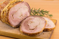Rolled pork on a cutting board. Rolled roasted pork meat on a cutting board Royalty Free Stock Photos