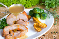 Rolled pork roast with Brussels sprouts Stock Images