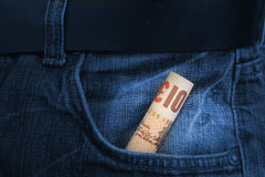 Rolled Pounds bill. Pounds bill in the pocket Stock Photos