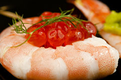 Rolled prawn sushi with salmon roe. Stock Photography
