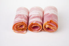 Rolled raw bacon slices Stock Photos