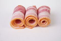 Rolled raw bacon slices Royalty Free Stock Images