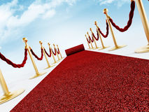 Rolled red carpet and velvet ropes Stock Photography