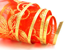 Rolled red gift ribbon Stock Photos