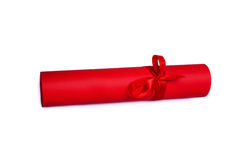 Rolled red paper with red tape Royalty Free Stock Photos
