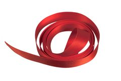 Rolled red satin ribbon. Isolated on white background Royalty Free Stock Image