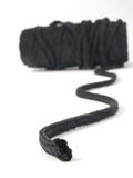 Rolled rope. Close up of a black rolled rope stock image