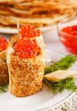 Rolled russian pancakes with salmon caviar Royalty Free Stock Photos