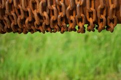 Rolled rusty chain with blurred natural background Stock Photo