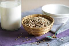 Rolled rye oats with milk and bowls for breakfast Royalty Free Stock Image