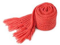 Rolled scarf. Rolled red textile scarf isolated on white background Royalty Free Stock Image